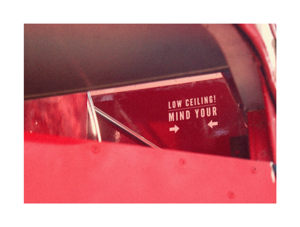 red walls and a sign that reads 'low ceiling mind your head'