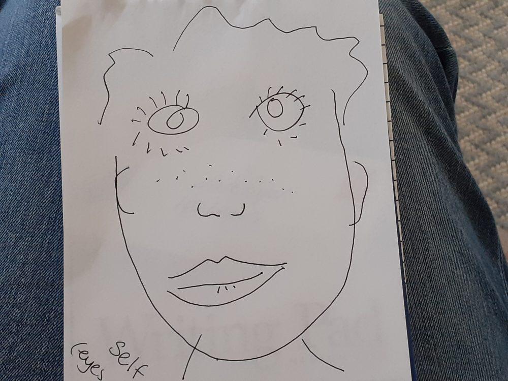 hand drawn self portrait in pencil
