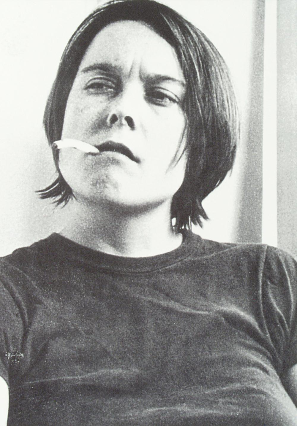 artist Sarah Lucas smoking a cigarette with long ash