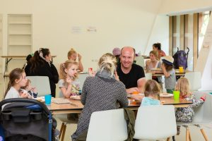 Families eating at Firstsite's Holiday Fun canteen
