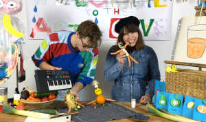 artists iris and tom in the art cave playing with vegetables